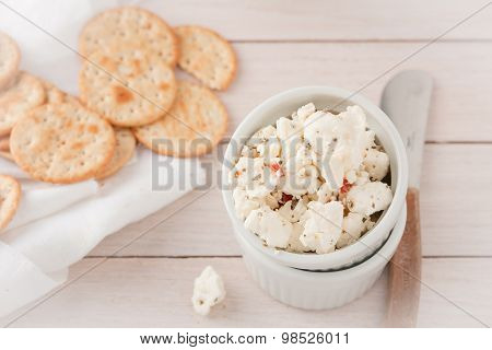 chunks of cheese with sundried tomatoes, herbs and spices