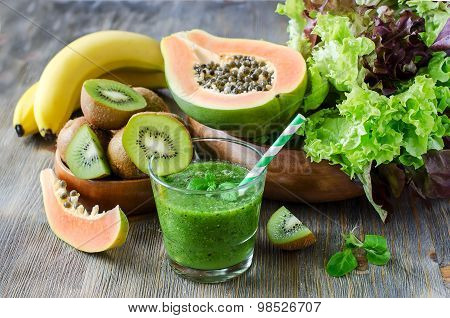 Green Smoothie With Kiwi, Papaya And Salad Leaves