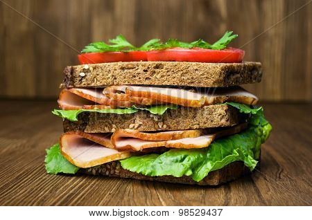 Sandwich With Ham, Tomatoes And Cucumbers