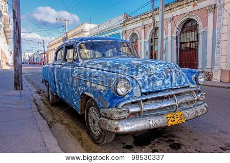 Patched up old American car in Cienfuegos, Cuba