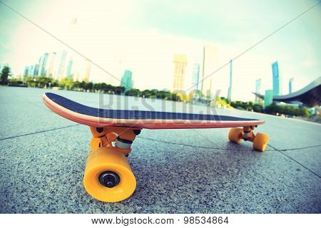 closeup of one skateboard on modern city
