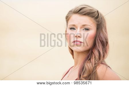 Young Woman Portrait In Large Wheat Field.