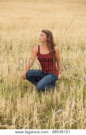 Young Woman Posing In Wheat Field.