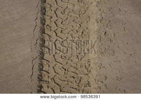The Trace Of A Tyre In The Sand On The Beach...