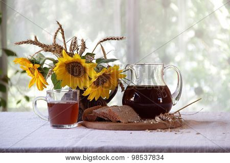 Kvass (kvas) On Rye Ferment, Bread And A Bouquet Of Sunflowers
