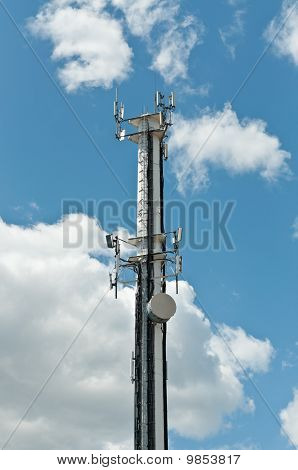 White Antenna Tower With Blue Sky And Clouds