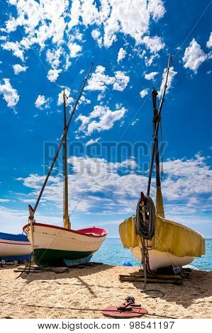 Fishing Boats In The Sand Of A Beach