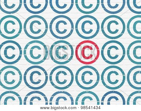 Law concept: copyright icon on wall background