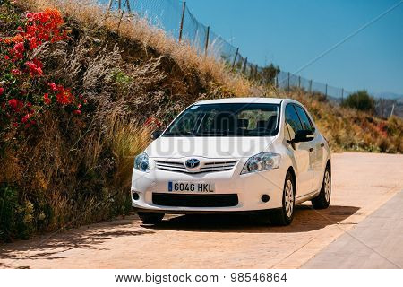 Toyota Auris car on Spain nature landscape