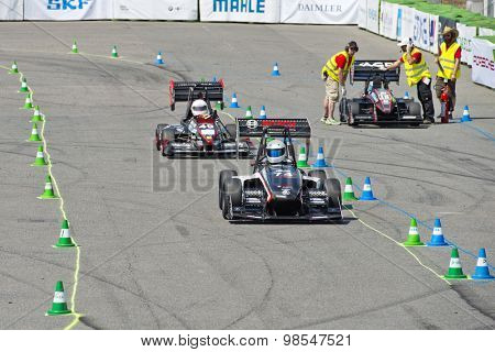 HOCKENHEIM, GERMANY - AUGUST 1, 2015: Close racing during the final Endurance Race of the officious world championships Formula Student on the Hockenheim Ring