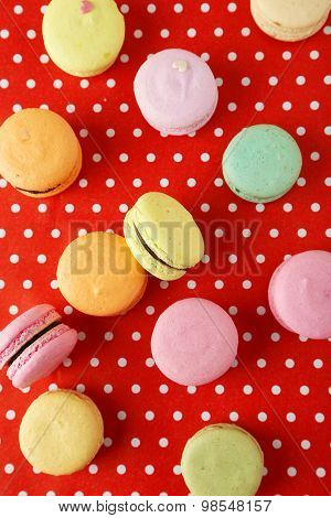 French Colorful Macarons On Red Background