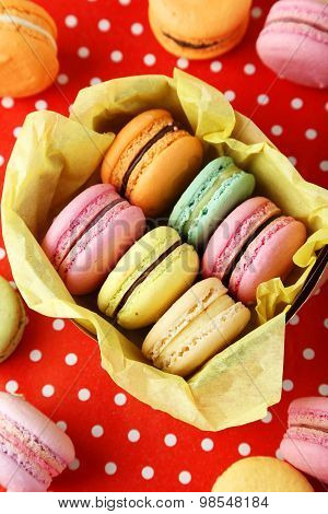 French Colorful Macarons In Box On Red Background