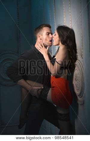Couple kissing passionately.