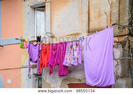 Drying Colorful Laundry On A Wire Outside The Window
