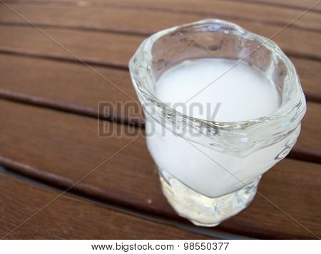 single glass with cold ouzu greek alcoholic drink on a table