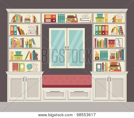 The window seat and wall of books for the home office