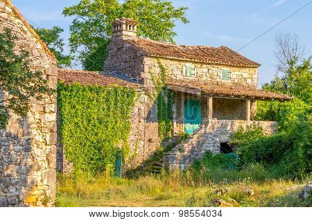 Old Stone Mediterranean House Ruins With Ivy And Grass