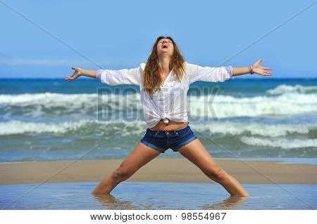 Young Attractive Woman In Shorts In Relax At Beach In Freedom Co