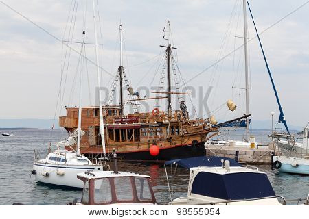 SELCE, CROATIA - JULY 24, 2015: Wooden excursion ship in marina Selce