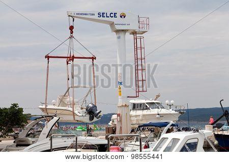 SELCE, CROATIA - JULY 24, 2015: A boat lift in Marina Selce