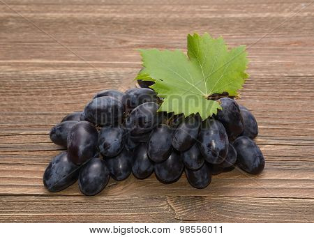Grapes on wooden background