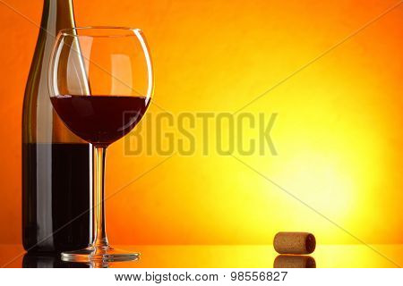 Red wine - still-life with glass and bottle with big space for text