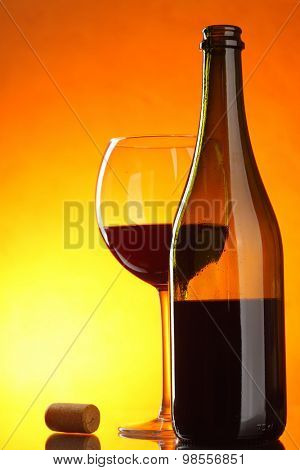 Red wine - still-life with glass, bottle and cork