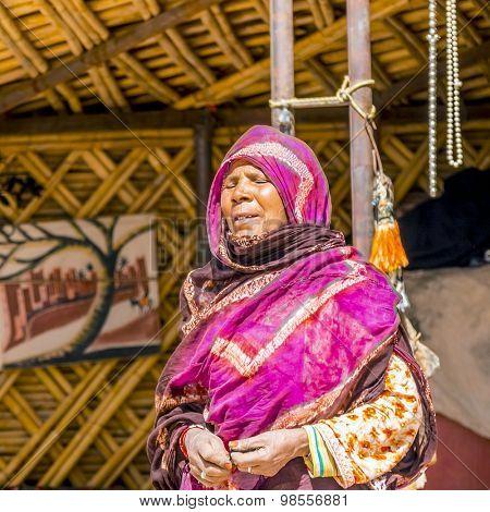 TAFILALT, MOROCCO, APRIL 12, 2015: Local nomad woman in traditional attire in her tent