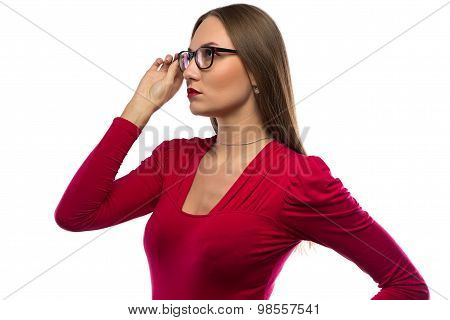 Photo of woman in red touching glasses