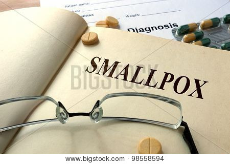 Word Smallpox on a paper and pills.