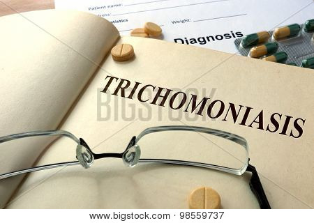 Word Trichomoniasis on a paper and pills.