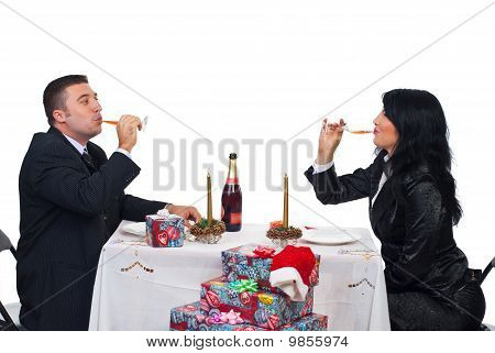 Elegant Couple Drinking Champagne At Christmas Table