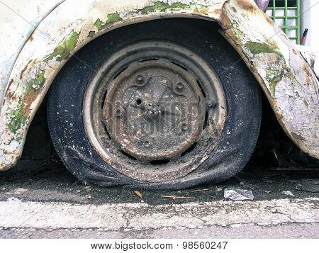 old car with a flat tire