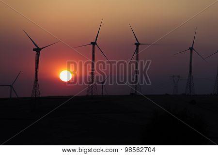 Silhouette Of Wind Turbines
