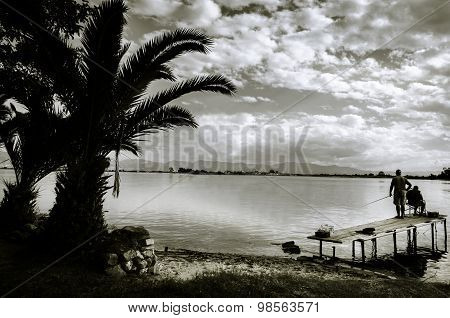 Fishermens At Mediterranean Lagoon In Black And White