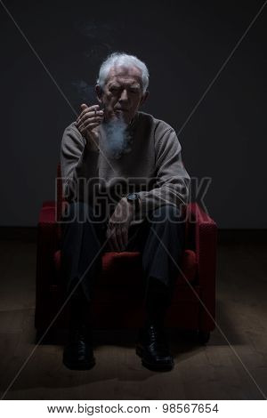 Senior Man Smoking Cigarette