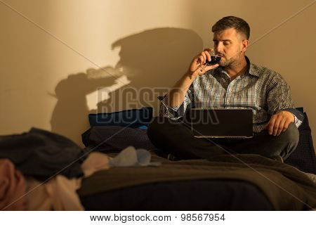 Mature Man Spending Evening Alone