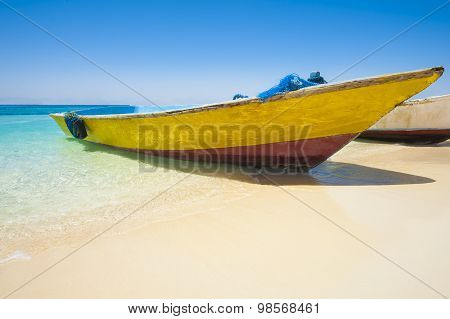 Traditional Wooden Boat On A Tropical Beach