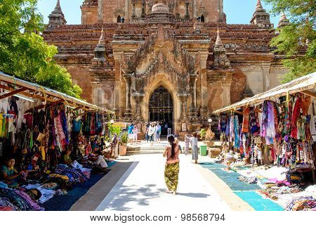 Bagan, Myanmar - June 30, 2015: Tourists And Local People In Front Of Old Temple In Bagan