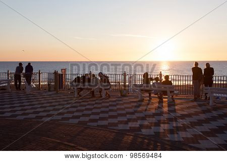 People Enjoying Sunset In Zandvoort, Holland
