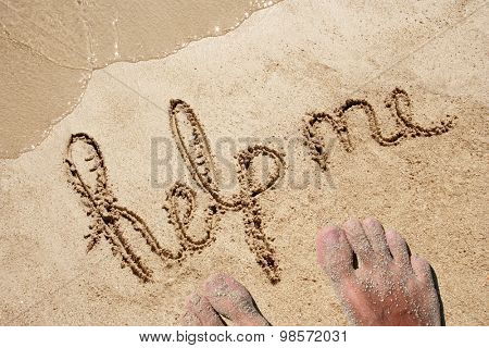 Concept or conceptual Help me text handwritten in sand on a beach on an exotic island background with feet