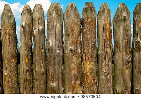 Old wooden fence over the sky and clouds