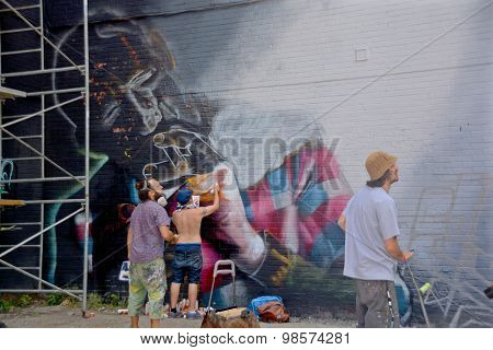 Young people paint a mural
