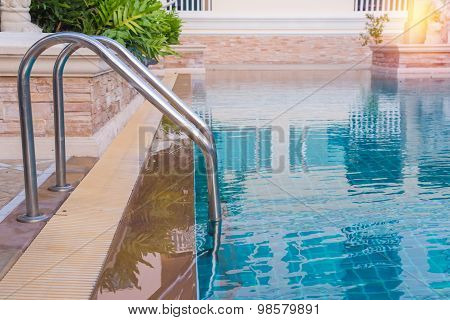 Blue Swimming Pool At Hotel With Stair.