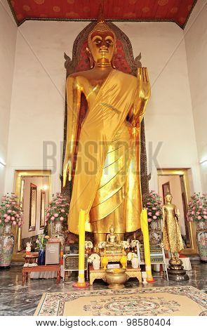 Statue Of Buddha Wearing In Yellow Sacred Fabric Clothing Called The Robe