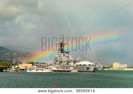 Rainbow directly above Battleship USS Missouri
