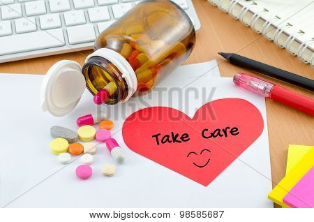 Health Care Concept - Supplement With Take Care Note On Red Heart Paper