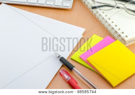 Blank Paper With Pen And Color Note Paper On Computer Desk