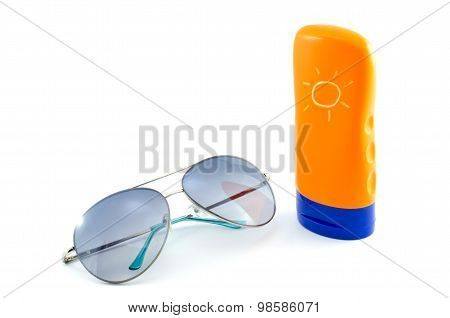 Sunglasses And Body Lotion On White Background