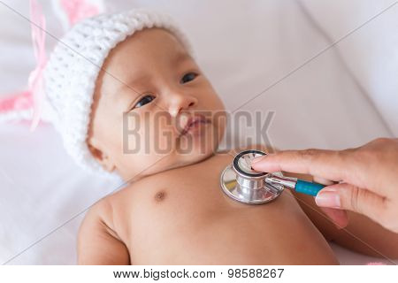 Pediatric Doctor Exams Newborn Baby Girl With Stethoscope In Hospital